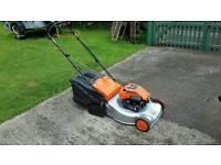 Petrol roller lawn mower