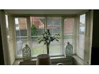 Cream wooden Venetian blinds