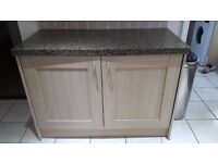 Intergrated fridge and freezer with beech doors and granite covered worktop