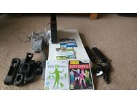 Wii Games console and Wii fit board with extras
