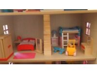 Wooden dolls house. Perfect condition. Includes lots of people & furniture