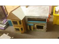 Old wooden dolls house with garage