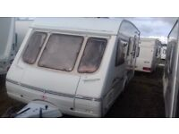 5 BERTH SWIFT CHARISMA. 2002 EXCELLENT CONDITION WITH NEW FULL AWNING. END SHUT OFF BEDROOM.
