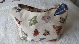 Lightweight beige handbag with butterflies on
