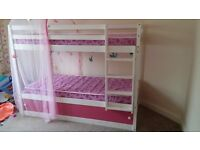 White/pink bunk bed with mattresses