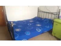 Double bed with mattress. Metal frame. Good quality.
