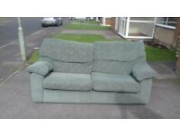 light green sofa and 2 armchairs