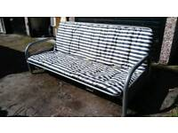 SILVER METAL FUTON WITH. BLUE & WHITE STRIPED MATTRESS GOOD CONDITION FREE LOCAL DELIVERY