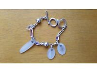 Swarovski mother of pearl and crystal charm bracelet with box and certificate (missing a crystal)