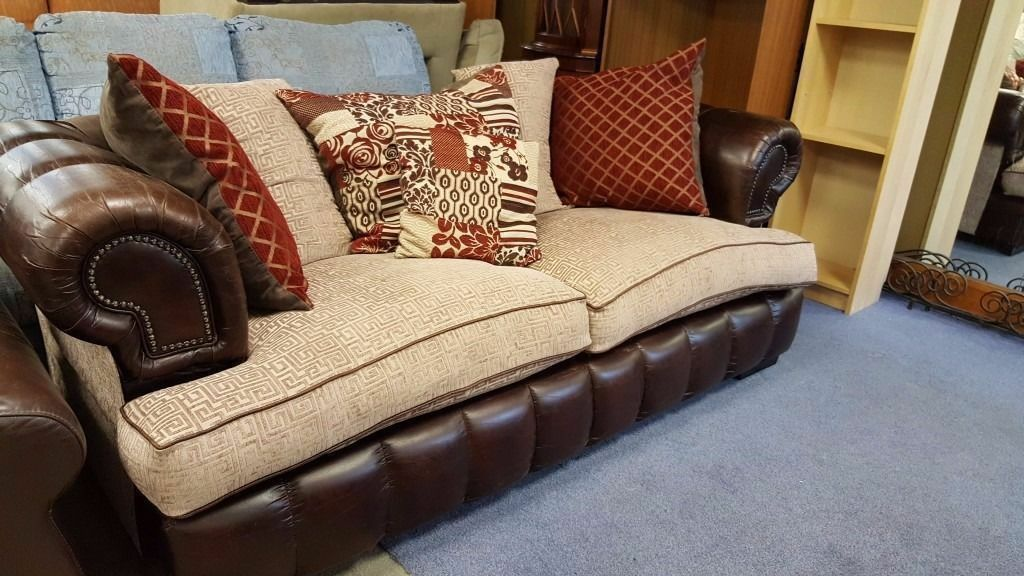 Pair Of Two Seater Dark Leather Chesterfield Sofas With Fabric Cushions In Excellent Condition
