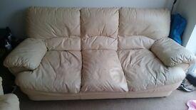 Cream leather sofa and single armchair