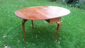 Wooden drop leaf table.