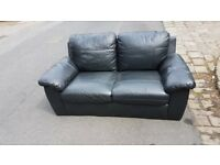 Black two seater leather effect sofa