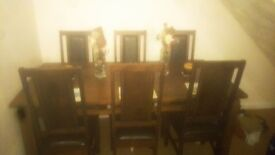 Dark wood table wuth 6 chairs