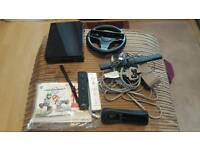 Wii consol with 2 controllers and wheel