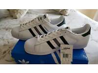 Adidas superstar trainers size 12, brand new