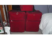 2 large suitcases and matching flight bag