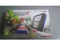 Brand new in box nintendo 2ds with preloaded mario kart 7