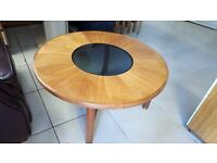 round wooden coffee table with glass center