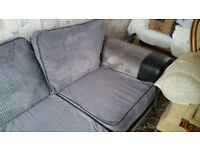 Grey and black L shaped settee, 4 seater.