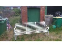 Very old 3 seater park bench.