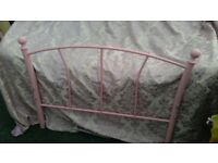 standard single pink metal bed base with wooden slats and heart headboard to match