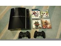 Immaculate Playstation 3 (PS3) plus 2 controllers and 4 awesome games