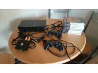 PlayStation 2with games and controllers