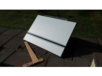 A2, desktop drawing board with t square and clips.