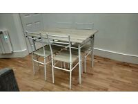 Dining table + 4 chairs, perfect condition