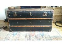 Fantastic antique black and wood trunk.