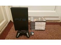 Playstation 2 with lots of Games/Memory Card