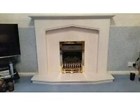Marble fireplace with a gas fire