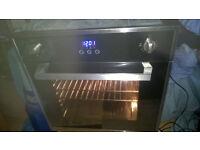 Integrated single fan oven