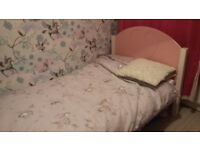 Girls single wood bedframe pink headboard