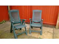 Good solid plastic green reclining deck chairs.