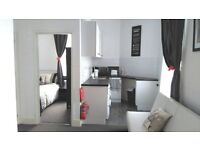 Modern 'slightly quirky' one bed unit with open plan living /dining area, kitchen & shower room