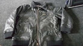 Kids faux leather jacket..worn once. no rips or tears. 5 years