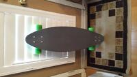 grey and green penny longboard