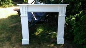 White painted fire surround.