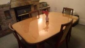 Extendable dining room table and 4 chairs with matching sideboard