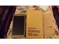 Samsung Galaxy S5 Neo (Octa-core version) in gold boxed with accessories on EE network