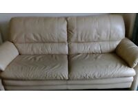 leather cream suite, two and a three seater, reasonably good condition