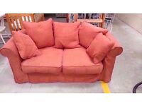 Red fabric two seater sofa