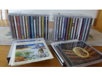 30 Music C.D.s Classsical, easy listening movies. Individual cases & storage boxes