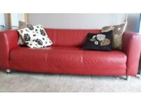 Leather sofa red - good condition and a nice bright place to chill and relax