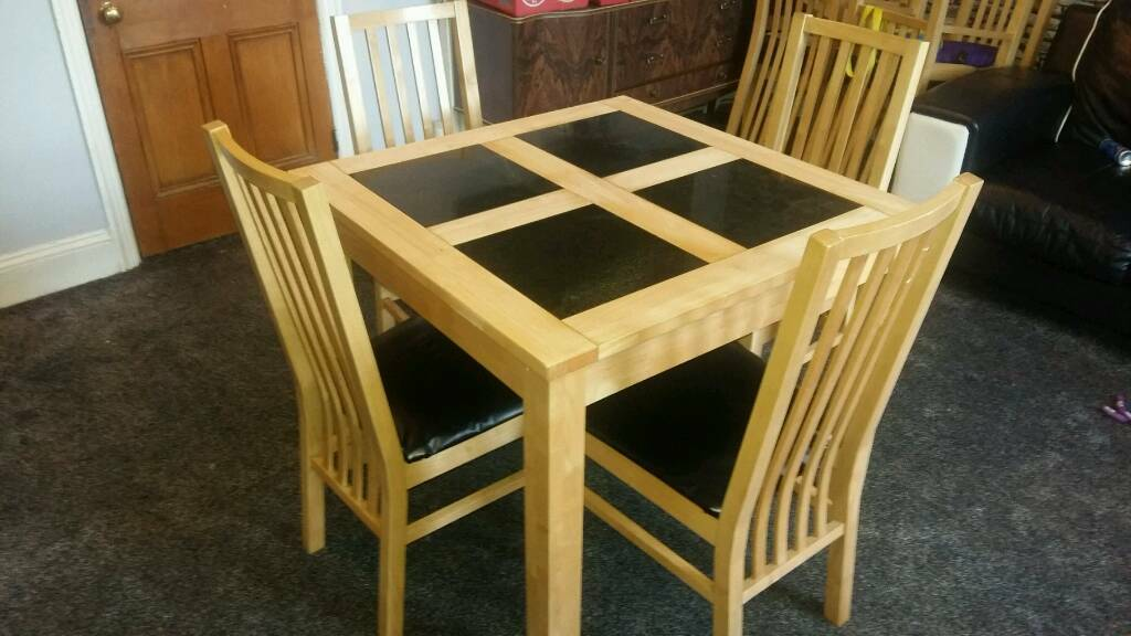 Solid wood and granite dining table and chairs