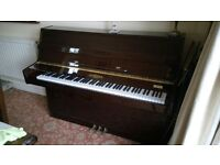 Hopkinson Upright Piano.