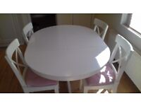 Like new extendalble dining table and chairs.