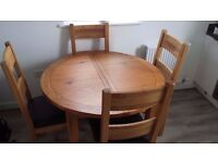 Lyon Extending round table + 4 wooden back chair (looks as good as new)